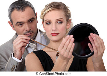 Make-up artist with model