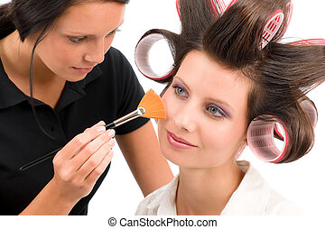 Make-up artist woman fashion model apply powder blush rouge...