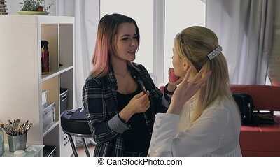Make-up artist work on her friend. Real people. beauty...