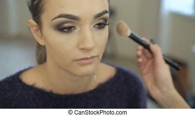 Make up artist working on a model