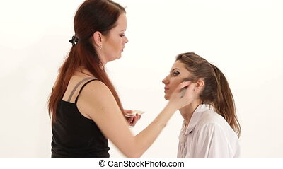 Make-up artist working with model's skin