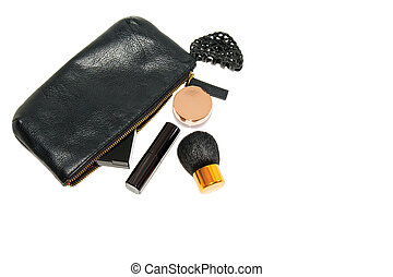 make up bag with cosmetics and brush on white background soft shadows copyspace