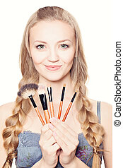Make-up. Beautiful woman with makeup brushes