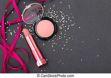 Make up beauty on glitter dark stone background