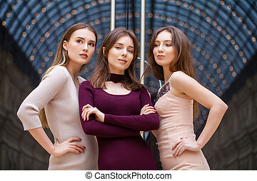 Three brunette young women, indoor