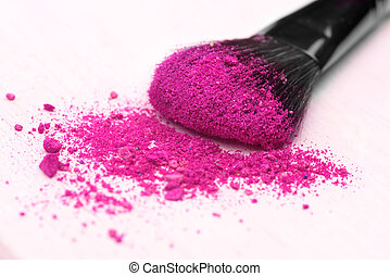 make-up brush on pink crushed eyeshadow
