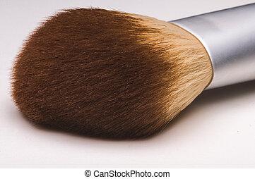 Make-up brush on white background.