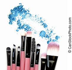 Make up brush set with eye shadow powder. Isolate.