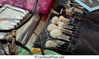 Make-up Brushes and the makeup on the table closeup