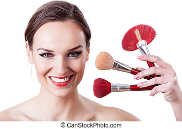 Make up brushes - Portrait of beautiful woman with make up...