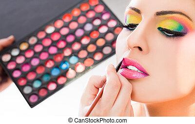 make-up lipstick - Beautiful woman having lipstick applied...