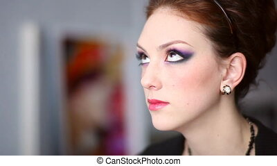 Make-up. - Model making-up for photography in studio.