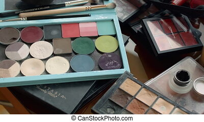 make up set, soft makeup brushes and makeup on the table