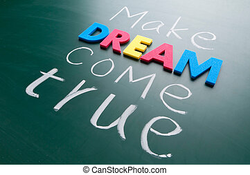Make your dream come true. Colorful words on blackboard.