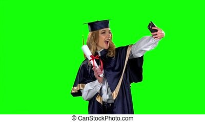 Makes the selfie photo with phone. Green screen. Slow motion