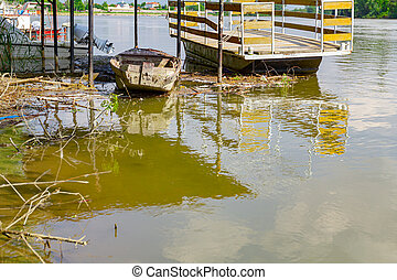 Makeshift pier on polluted river coast