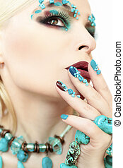 Makeup and manicure with turquoise.