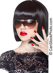 Makeup and manicured polish nails. Fashion brunette woman wearin