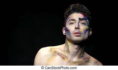 Makeup art, young man.