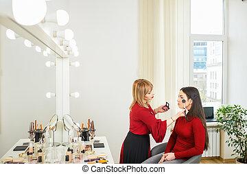makeup artist apply blush