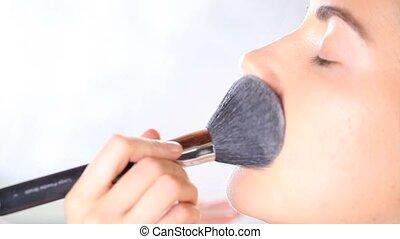 makeup artist apply powdered, brush - makeup artist with...