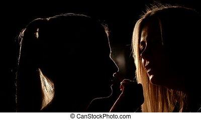Makeup artist applying eyeshadow. Closeup.