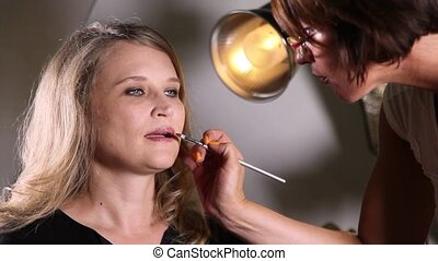 Makeup artist applying make up
