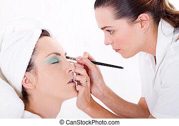 makeup artist applying makeup - professional female makeup...