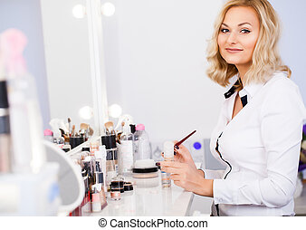 Makeup artist at his workplace in the mirror preparing tools to get started. Pending customer. Beauty salon.
