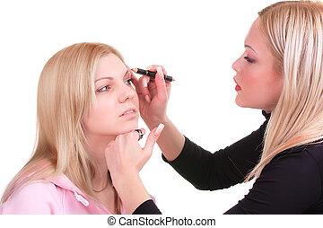 Makeup artist at work - Stylist is applying eyebrow pensil ...