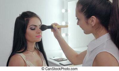 makeup artist doing makeup