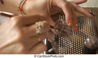 makeup artist mixes in a jar of paint for eyebrows - makeup...