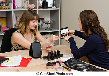 Makeup artist picks up the shade for a client