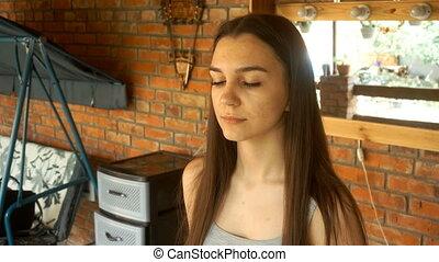 makeup artist rubs young girl thick black eyebrows