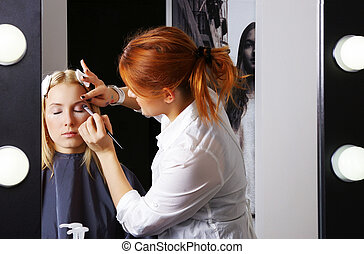 Makeup artist tracing the lilac eye shadow