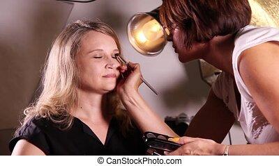 Makeup artist working with makeup - Makeup artist makes...