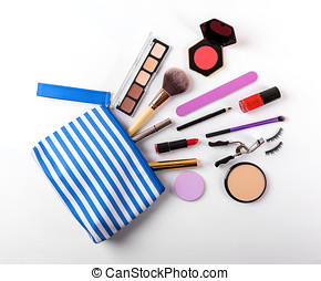 makeup bag with cosmetics on white background. top view