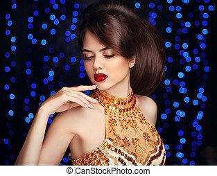 Makeup. Beautiful fashion woman in gold