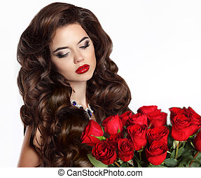 Beautiful young woman with bouquet of red roses isolated on white background