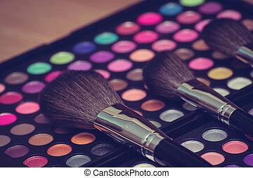 Makeup brush and eye shadow - Vintage looking colorful eye ...