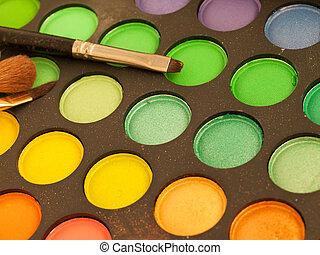 Makeup brush and make-up eye shadows palette
