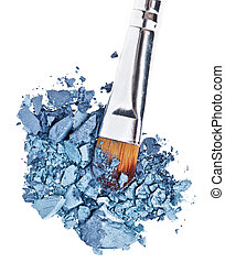 Makeup brush with grey blue crushed eye shadow, isolated on white macro