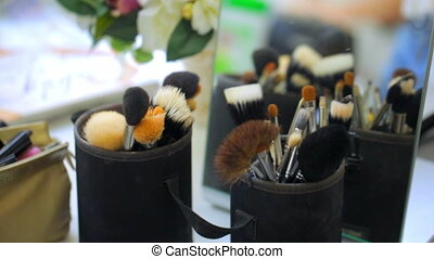 makeup brushes are on the table