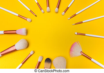 Makeup Brushes circle on yellow background