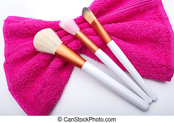 Makeup Brushes on pink  bow towel