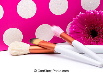 Makeup Brushes on polka dots pink background