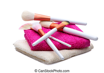 Makeup Brushes on white-pink towel