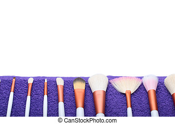 Makeup Brushes set on purple towel