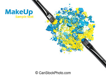 Makeup brushes with blue and yellow eyeshadow - Close-up of...