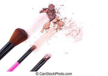 Makeup brushes with eye shadow on a white background